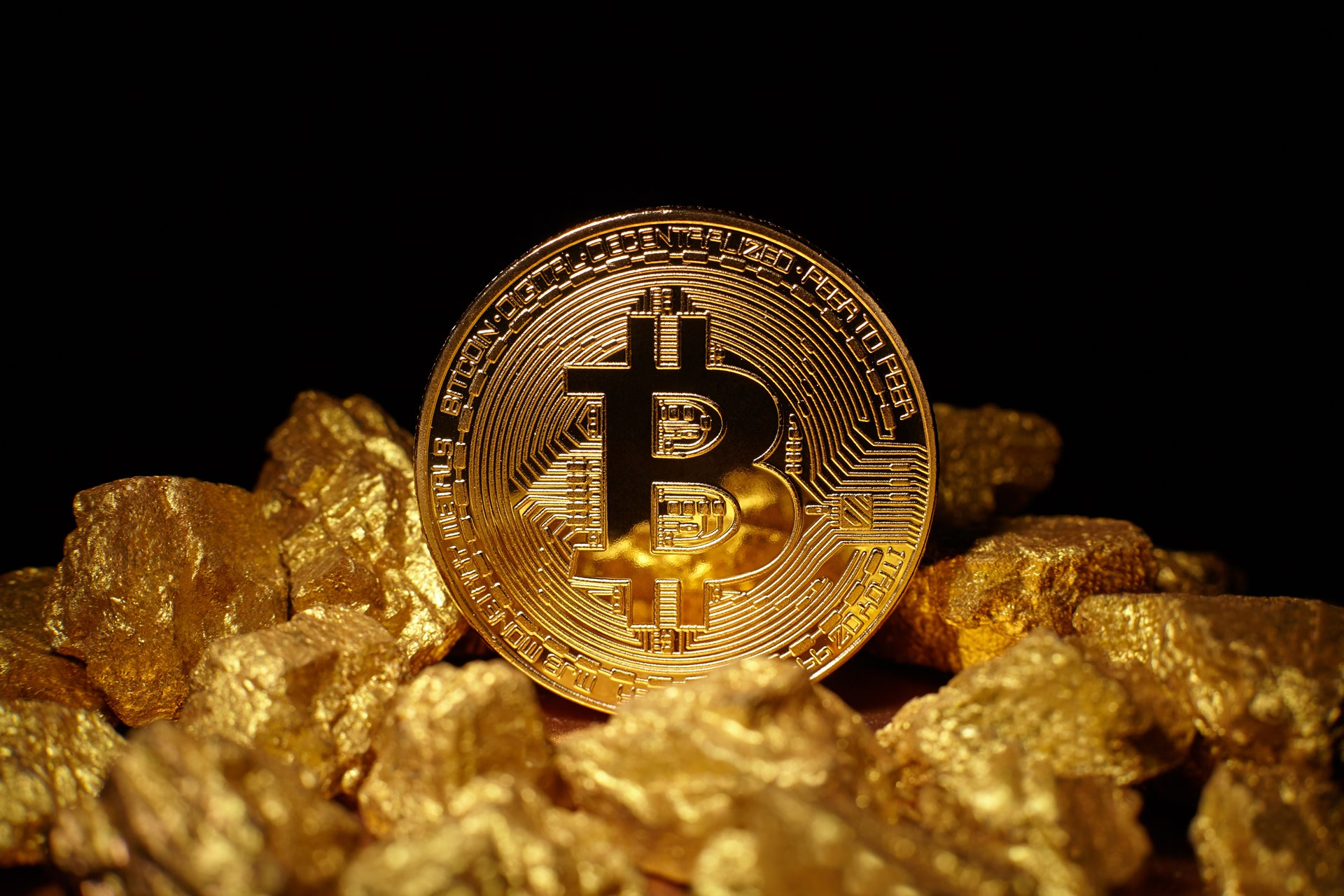Bitcoin hits all-time high against gold as haven battle rages